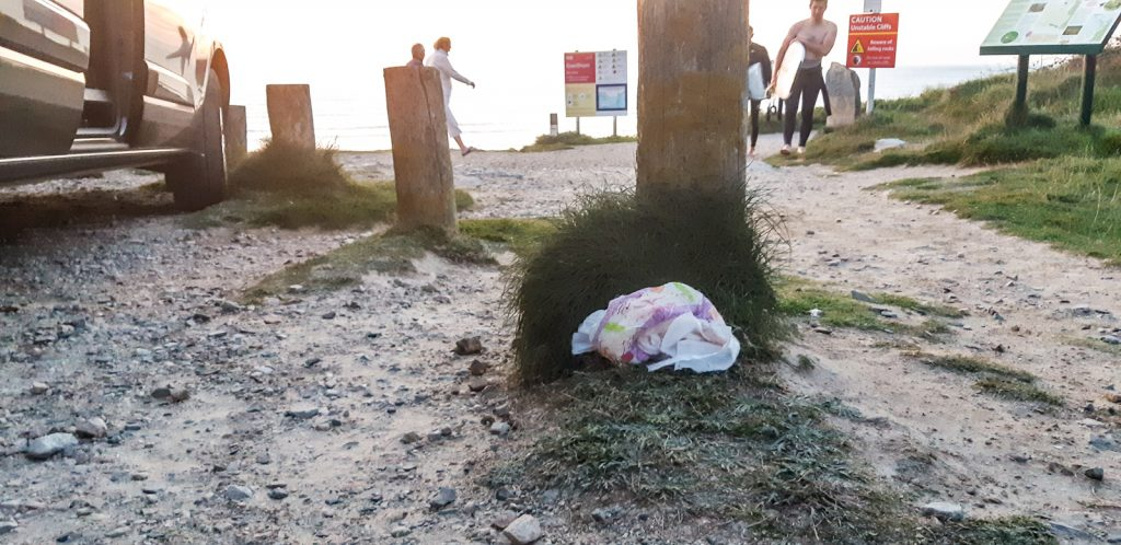 Create less rubbish on holiday - A discarded nappy in the sunset