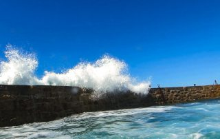 Sennen Harbour wall and wave
