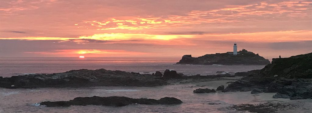 Stand up Paddleboard tour and things to do - Godrevey Lighthouse sunset